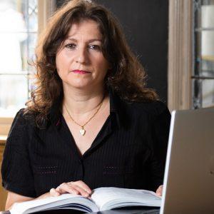 Anila Bara reading a book