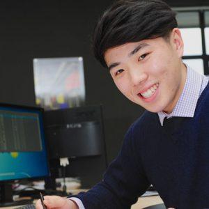 Joyin Li sat in an office